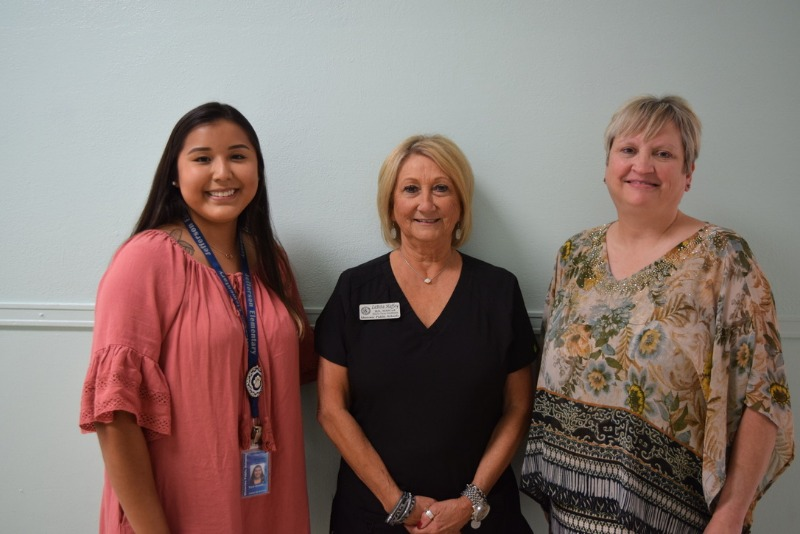 Ensuring students have the hygiene supplies and information they need at Jefferson Elementary are (from left) Native American Advisor Tara Goodfox, District Nurse Health Coordinator La Rita Haffey, and Counselor JoLynne Camp.