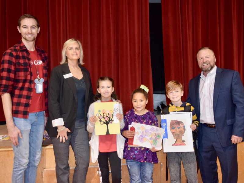 Pictured are (from left) Trevor Mastin, Will Rogers art teacher; Dr. April Grace, superintendent; Karlee Fuller, third place; Madilynn Carter, second place; Booker Dahlman, first place; and Kyle Rosebure, BancFirst Insurance Services agent/broker and spon
